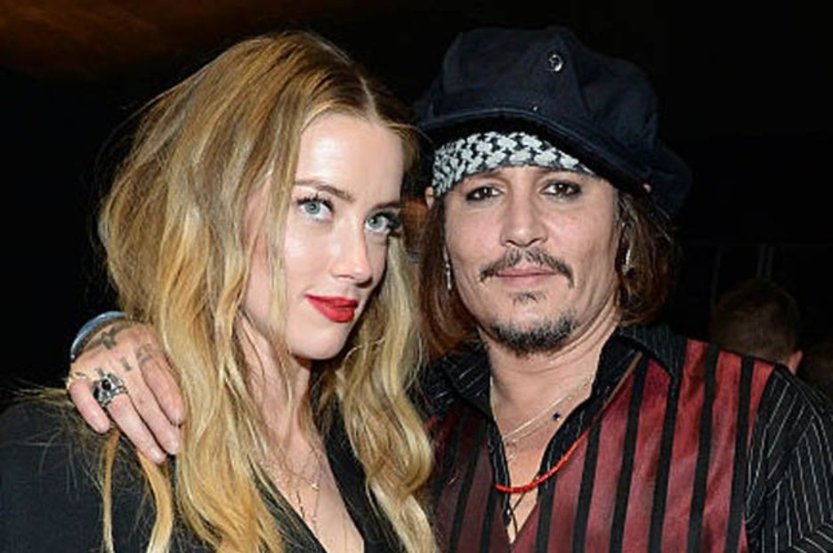 Amber Heard denies putting out cigarette on ex-husband Johnny Depp's face