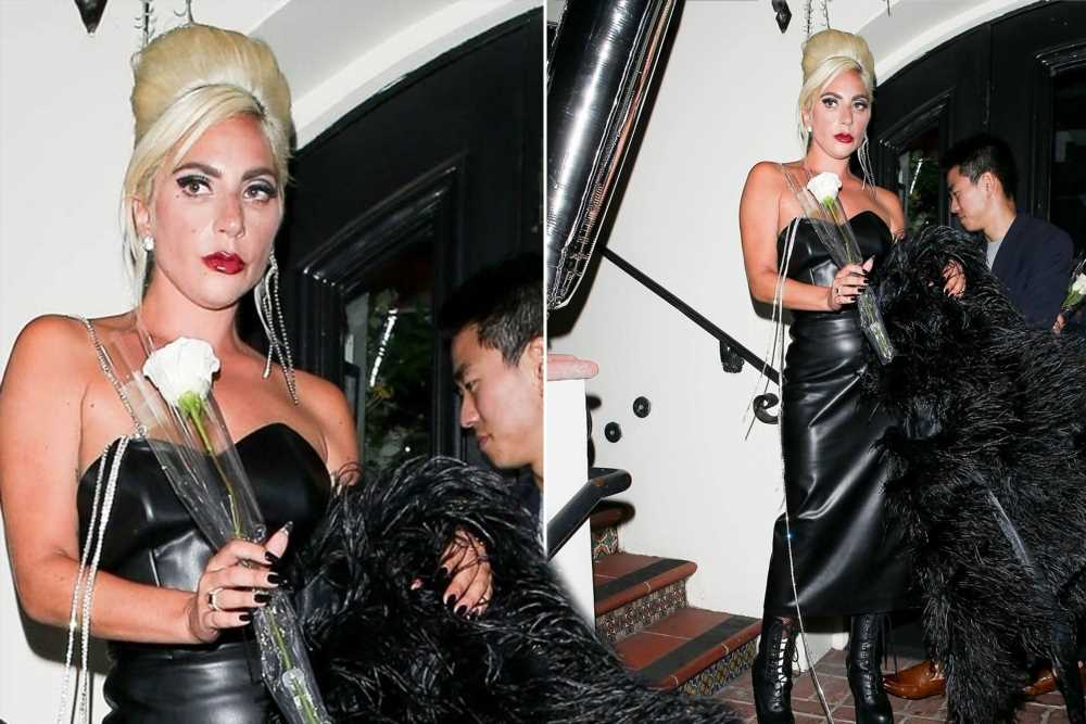 Lady Gaga celebrates makeup line in leather and feathers