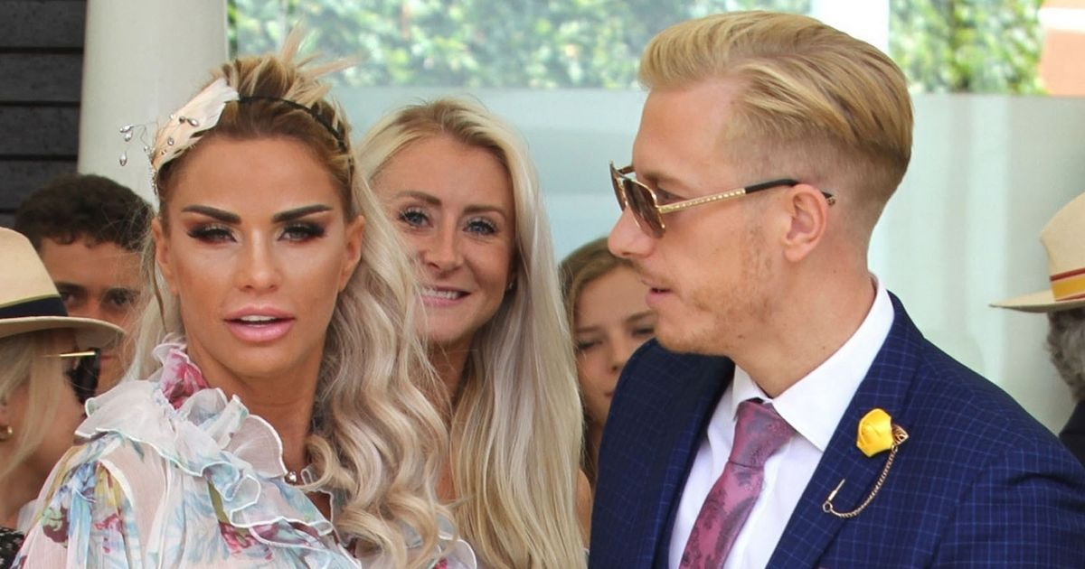Katie Price goes braless at the races as her engagement ring goes back on