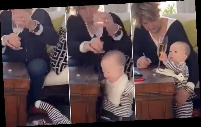 Video shows woman grabbing glass of fizz and letting baby fall