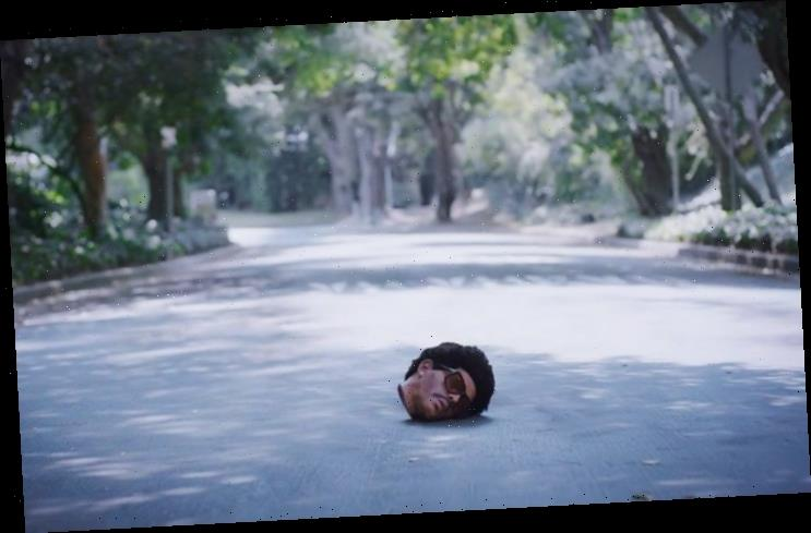 The Weeknd's Severed Head Charms Strangers in Bloody 'Too Late' Music Video