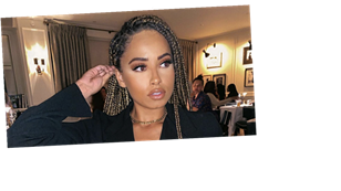 Amber Gill defends posting holiday pictures in Dubai as one fan tells her it's 'bad for mental health'