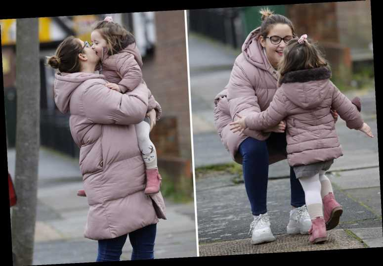 Jacqueline Jossa dotes on her mini-me daughter Mia as they wear matching pink coats for Christmas shopping