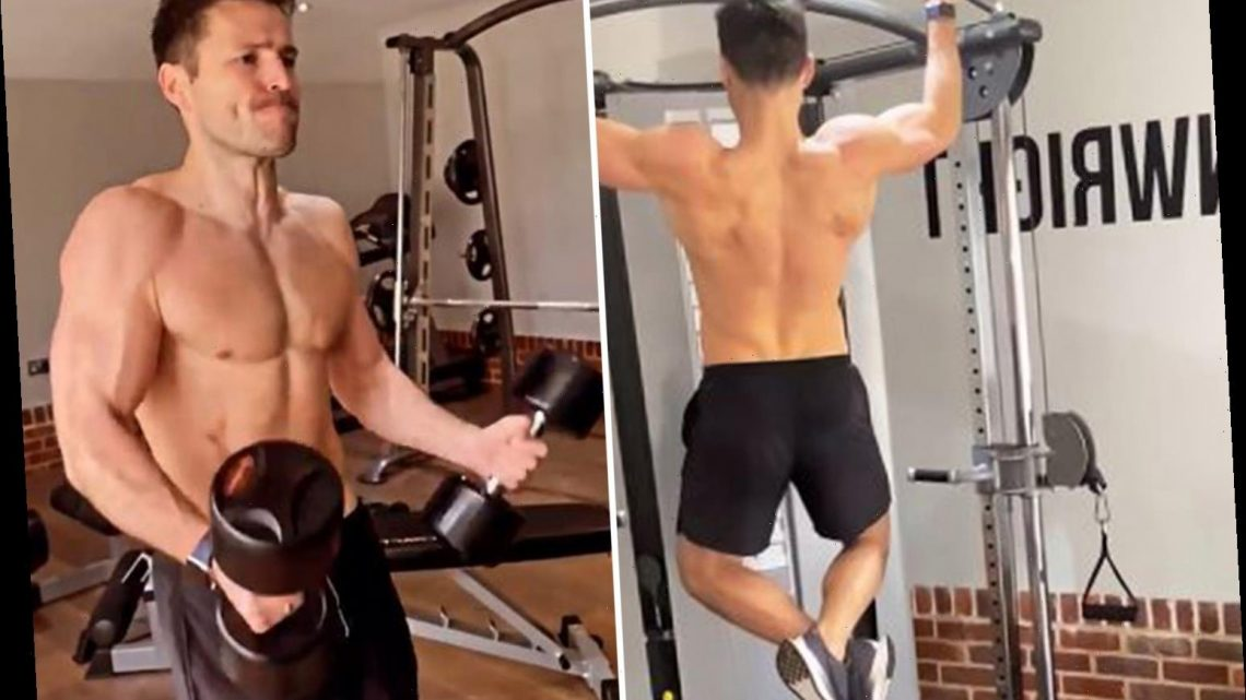 Mark Wright shows off his six pack as he works out in gym at home he shares with Michelle Keegan