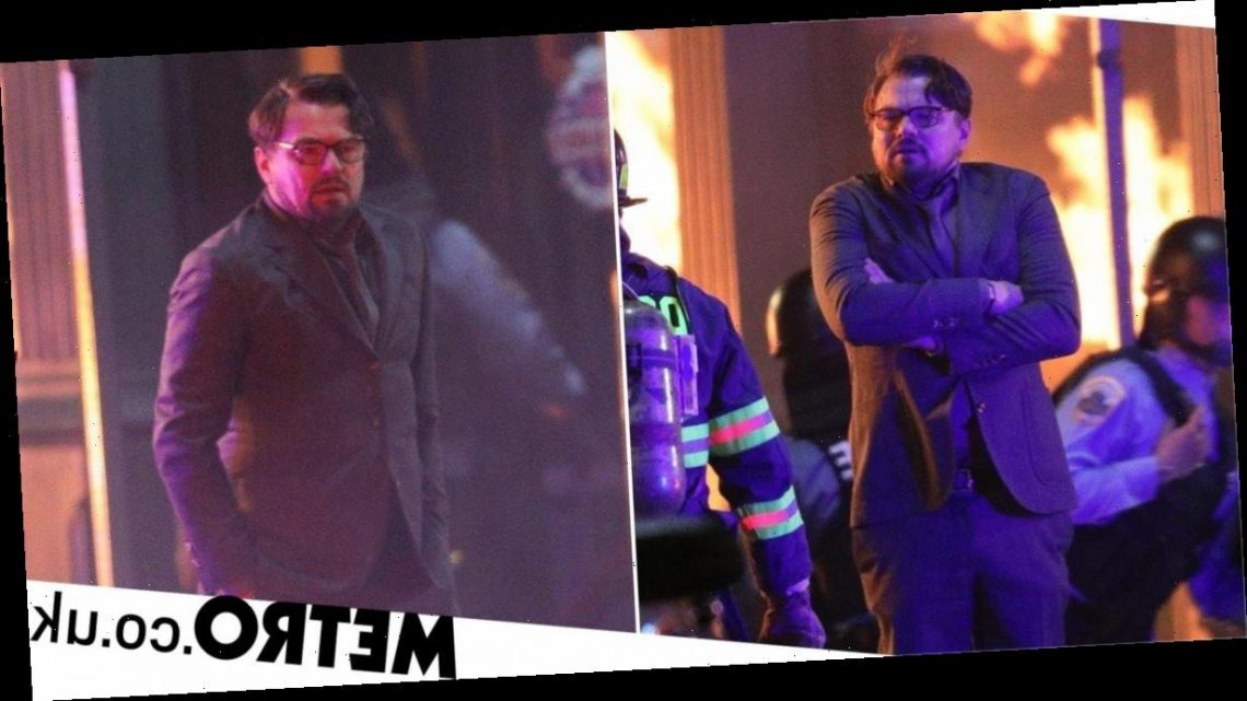 Leonardo DiCaprio surrounded by flames as he films riot scenes for Don't Look Up