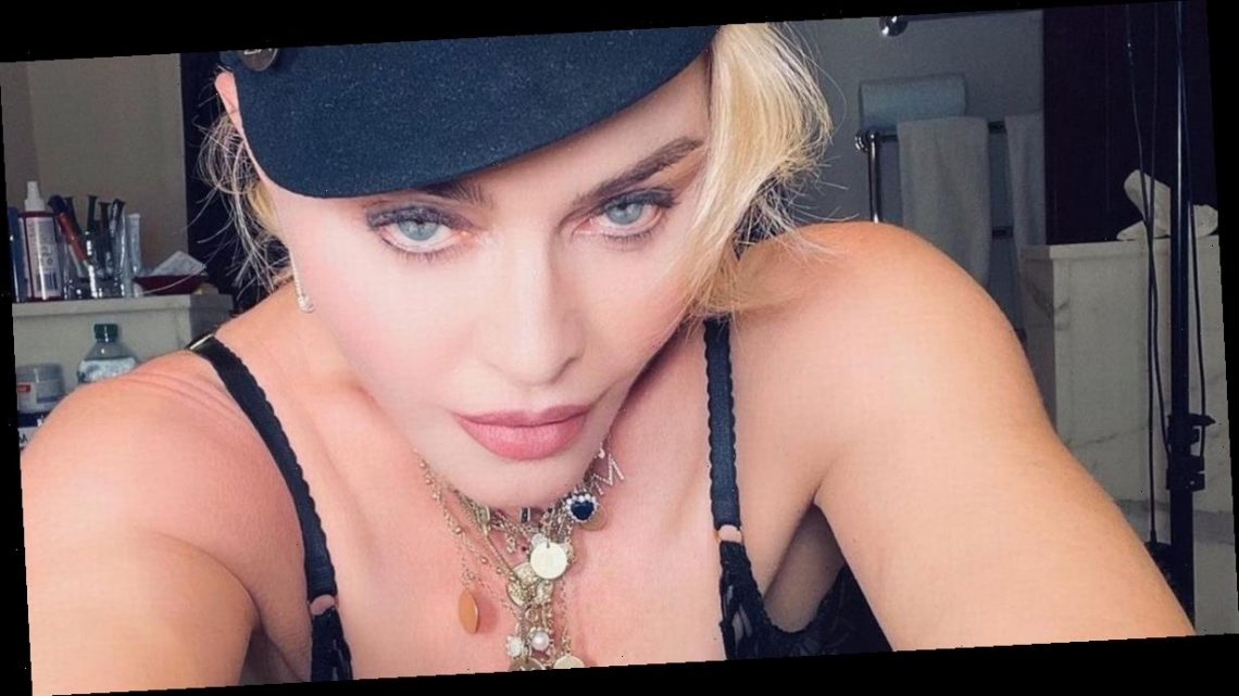 Madonna spills out of risqué lace lingerie as she wows fans with racy new snaps