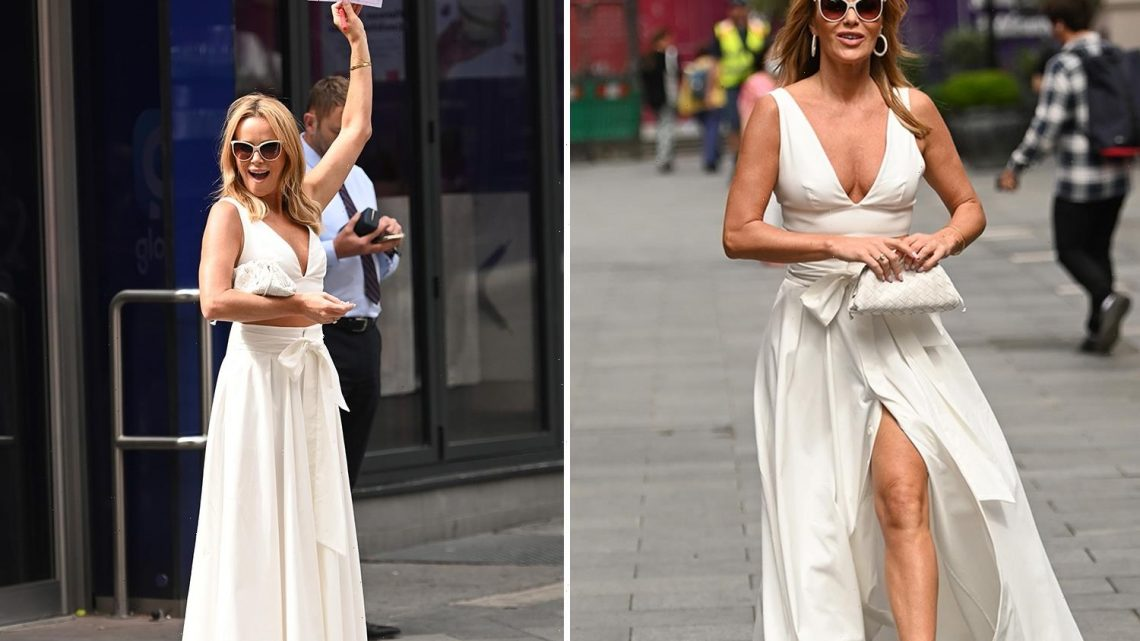 Amanda Holden stuns in low cut crop top as she wears all-white outfit in London