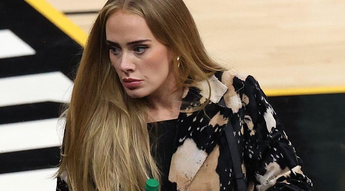 Adele confidently shows off seven stone weight loss as shes spotted at NBA game