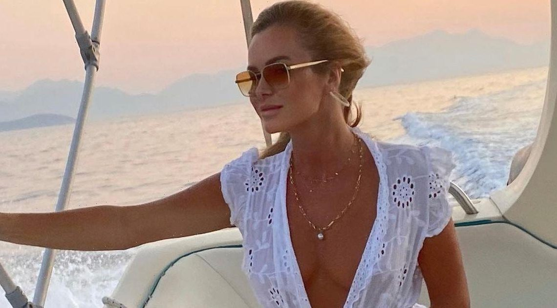 Amanda Holden flashes cleavage in braless display as dress flies up on boat trip