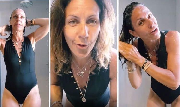 Julia Bradbury, 51, wows in plunging button-up swimsuit as she shares candid shower video