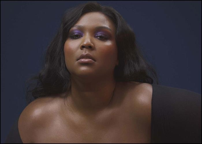 Lizzo Jokes Shes Pregnant With Chris Evans Baby