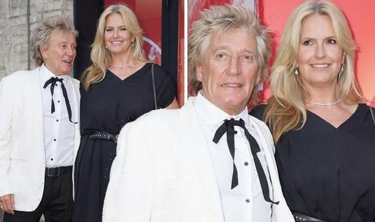 Rod Stewart, 76, and wife Penny Lancaster, 50, hold hands on red carpet in matching looks