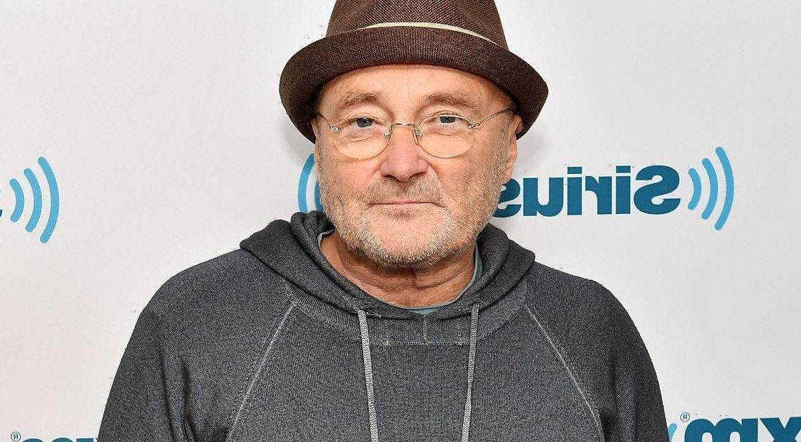 Phil Collins stays seated on stage after sharing he can barely hold drumsticks